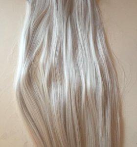 Волосы на заколках искусивенные