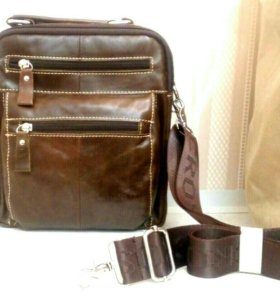 Кожаная сумка интересного дизайна