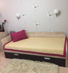 Кровать с дополнительным спальным местом.