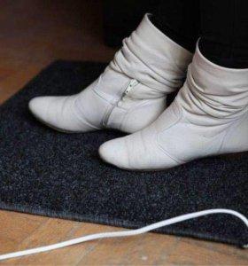 Подогреваемый коврик для сушки обуви.