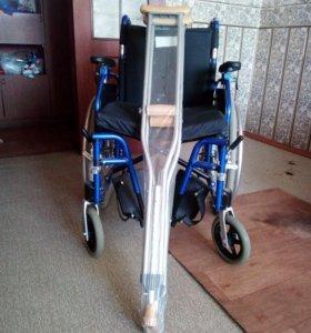 Новая инвалидная коляска и костыли.