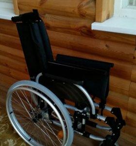 Новая инвалидная коляска с ручным приводом