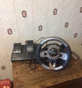 Игровая приставка руль и педали почти новый.