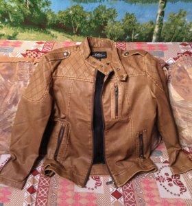 Новая кожаная куртка.