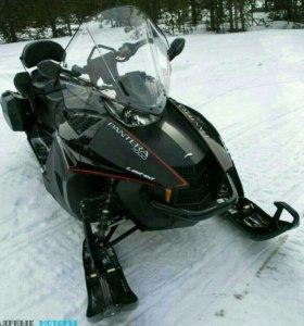 Стоянка снегоходов