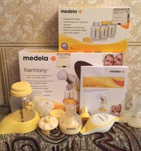 Молокоотсос Medela ручной+ 3 бутылочки Medela.
