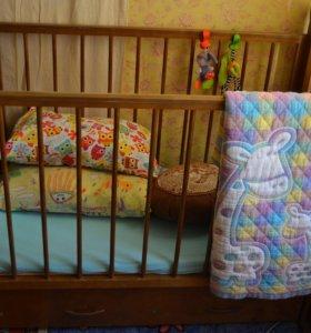 Детская кроватка с маятниковым качением