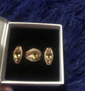 Серебрянные кольцо и серьги