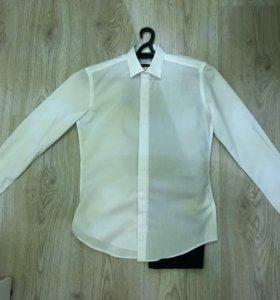 Костюм мужской(белая рубашка+синие брюки) размер М