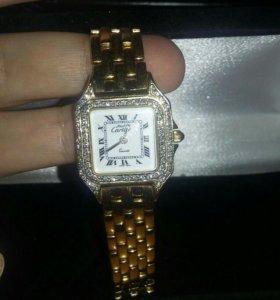 Золотые часы Сartier женские