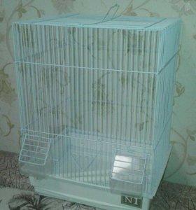 Клетки для попугаев и хомяков.