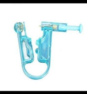 Одноразовый пистолет для прокола уха