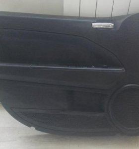 обшивка двери(водительская) додж калибр