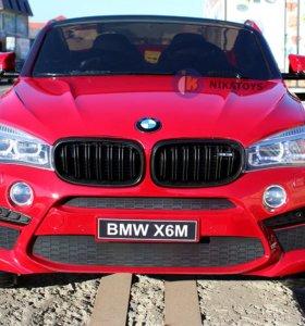 Электромобиль BMW X6 в бордовом цвете