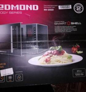 Продам Новую микроволновую печь REDMOND RM-2302D