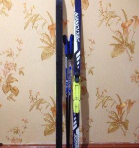 Комплект лыжи и лыжные палки(б/у).Крепление NNN.