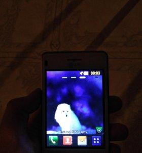 Телефон LG T370.