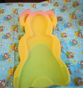 Подкладка для купания младенцев.