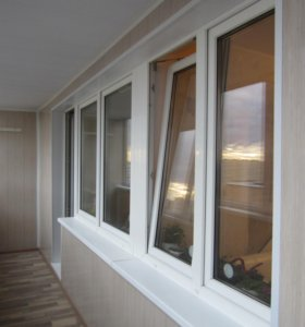 Отделка, утепление, объединение балконов с кухней