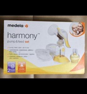 Молокоотсос Medela harmony+пакеты авент в подарок!