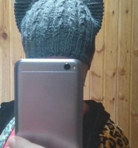 Вязаная шапочка кошечка