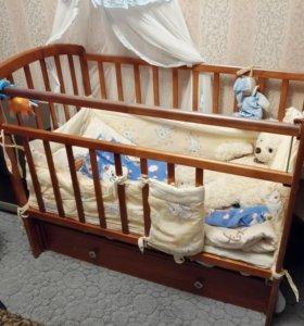Кроватка с продольным маетником