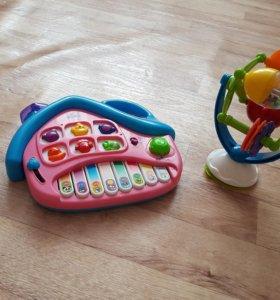 Продам музыкальную развивающие игрушки