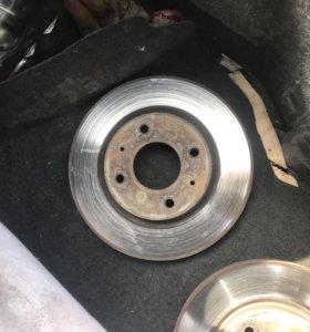 Тормозные диски на Лансе 9 передние