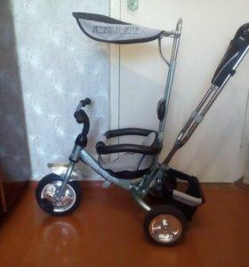 Велосипед-коляска с ручкой