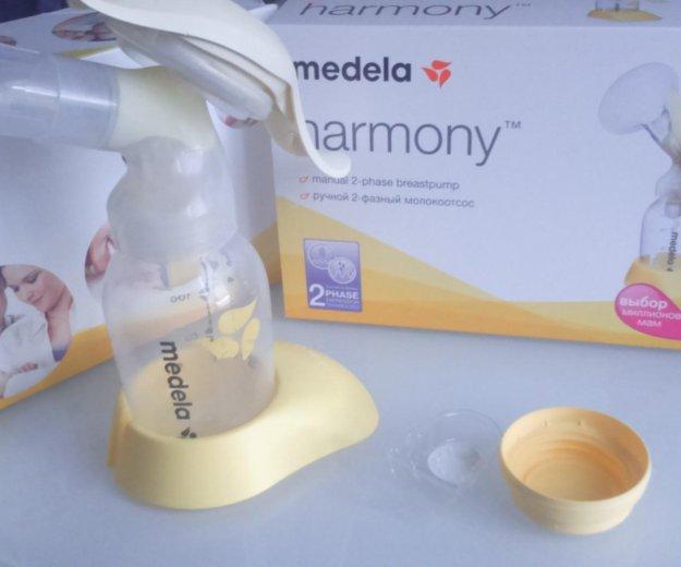 Молокоотсос medela ручной(не пользовались). Фото 1.